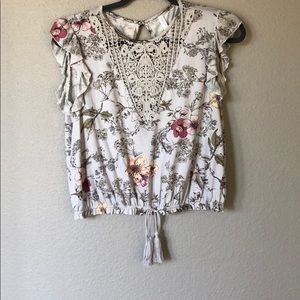 Floral top with lace detail and tassel bottom